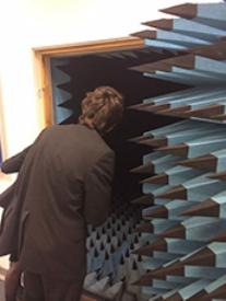 Colston students peer inside the anechoic chamber