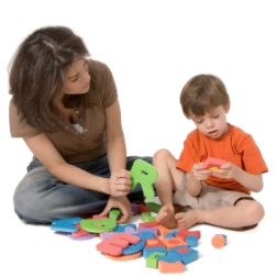 woman and child play with blocks together