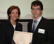 Philip Pearson receives his award from Marissa Dineen, GE Managing Director of Corporate Financial Services Europe