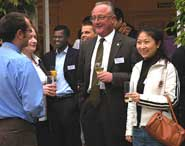 Professor Eric Thomas (centre) with staff and students at the scholarship reception