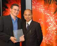 Edward Moline (left) receives his award from shoe designer, Jimmy Choo