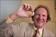 Professor Terence Cosgrove holding a piece of Clean Gum