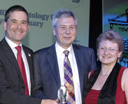From left: Simon Gillespie, Chief Executive of the MS Society (sponsor of the Long-Term Conditions category), presents the award to Professor John Kirwan (University of Bristol) and Professor Sarah Hewlett (UWE)