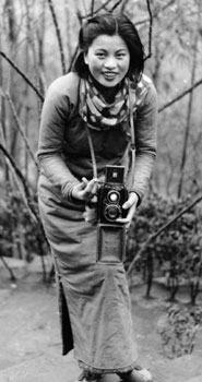 Min Chin posing with a camera at Northern Hot Springs in Sichuan province, 1940
