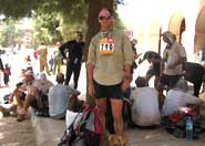 Professor Nick Norman (still standing) at the end of the Marathon des Sables in Tazzarine