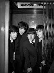 "Going Up, Empire Theatre, Sunderland, England, February 7, 1963: ""I posed the boys in the elevator to signify their song 'Please Please Me' was on its way up the charts."""