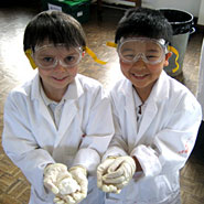 Two pupils from Moss Hall school taking part in a science workshop