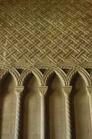 The twelfth-century Chapter House has walls so covered in carved patterns that they look more like a tapestry than a building