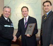 From left to right: Superintendent Geoff Spicer of Avon and Somerset Police presenting the award to Jerry Woods, Security Services Manager and Parviz Partow, Director of Estates Services, Bristol University.