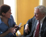 Sir David Attenborough talking to a guest at the opening of the new Animal Welfare and Behaviour building.