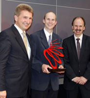 Dr Neil Fox (centre) receiving his award at E.ON's headquarters in Düsseldorf.