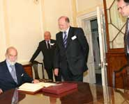 HRH Prince Michael of Kent signing the University's visitors' book with [from left to right] Colonel Sam Gaussen, Director of NERC, Professor David Clarke, Deputy Vice-Chancellor and Andrew Dick, Professor of Ophthalmology