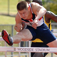 Lawrence Clarke competing in a hurdles race