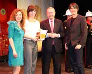 Hannah receiving her award from Kate Bellingham, Professor Brian Cox and Sir John Beddington