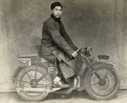 Young man on a 'motorbike' in a photographer's studio, probably in Shanghai, c.1950. Print purchased in a junk shop, Jing'an district, Shanghai, 2010. Photographer unknown.