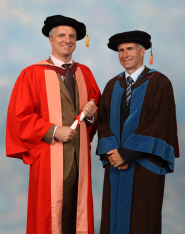 Ben Morris receives his honorary degree from Professor Stuart Burgess
