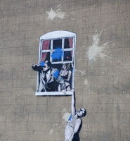 Artwork by Banksy on the wall of a clinic in Park Street, Bristol