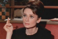Actress Audrey Hepburn smoking in the film Charade