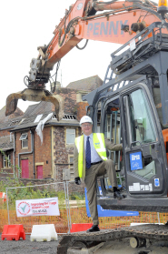 Vice Chancellor Professor Eric Thomas signifies the start of demolition work on the site of the Old Children's Hospital