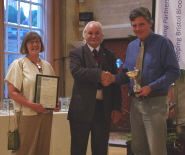 Carole Webb, Chairman of the Friends of the Botanic Gardens, and Nick Wray, Curator of the Botanic Gardens, receive the award from Deputy Lord Mayor of Bristol Colin Smith