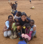 Juliette Denny with local children in Kenya