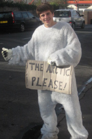 Marcus Scaramanga in his polar bear suit trying to hitchhike to the Arctic
