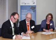 Truett Tate, Lloyds Group Executive Director, Prof Nick Lieven, Pro-Vice Chancellor of Bristol University, and Prof Rebecca Hughes, Pro-Vice Chancellor of Sheffield University, signing the contract to launch the Lloyds Scholars Programme at the bank's London headquarters