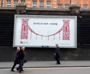 The Discover More billboard at Paddington Station
