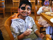 A youngster shows off his face painting at the Christmas Party