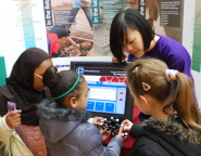 Youngsters get to grips with an exhibit