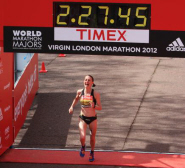 Claire Hallissey crosses the finish line at the Virgin London Marathon