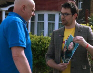 Ted Wilkes, right, speaks to someone about Kim Jong-Un for the 'Embracing Kim' mockumentary