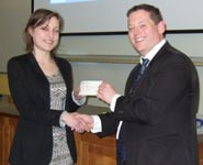 Alan Bailey, Chairman of Low Carbon South West, presenting Jo Humphrey with her £500 winner's prize