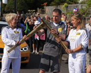 Shirley Hume passes the flame to fellow torchbearer Georgie Twigg