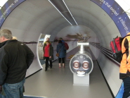 Visitors enjoying the model of the LHC tunnel