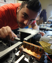 PhD student Erman Engin measuring the performance of a silicon quantum chip.