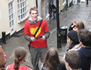 James with a tour group on Christmas Steps