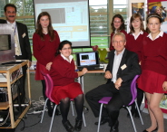 Zino Dif, Head of Physics at Red Maids', and Professor Bob van Eijk with pupils at Red Maids' School