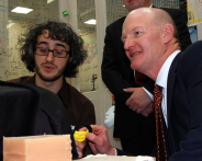 Dr Adam Spiers, from the Bristol Robotics Laboratory demonstrates telehaptic technology to David Willetts, Minister for Universities and Science