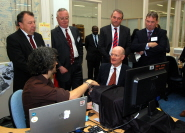 Dr Adam Spiers, from the BRL, demonstrates telehaptic technology to David Willetts. Back row (l-r): Mr David Gillatt (Lead Consultant in Urology, North Bristol NHS Trust and Medical Director of the Bristol Urological Institute, Professor Eric Thomas (Vice-Chancellor, University of Bristol), Dr Mark Callaway (Consultant Radiologist, UH Bristol NHS Foundation Trust) and Professor Steve West (Vice-Ch