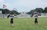 Marcus and Nick celebrating the end of their cycle challenge in Washington