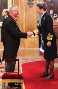 Professor Sir Eric Thomas is knighted by Princess Anne at Windsor Castle