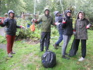 Volunteers collect rubbish in the garden at Easton Community Centre