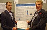 Tomos Edwards (left) is awarded first prize for his poster presentation by Chris Head, CEO of Meningitis Research Foundation
