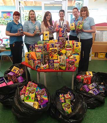 Emily Brasher, Kayleigh Knowlson with nurses from Bristol Children's Hospital and donated Easter eggs