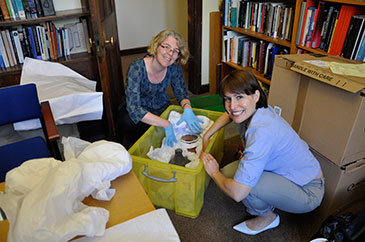 Image of Dr Alexandra Fletcher (left) and Dr Tamar Hodos packing the items at Bristol's Department of Archaeology in preparation for moving them to the British Museum