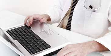 Doctor referring to the internet