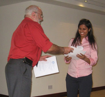 Tanu Singh receiving her prize from Nigel Goody, President of British Hydrological Society