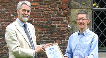 Professor Mike Mendl (right) receives the UFAW Medal from Dr Robert Hubrecht, UFAW Chief Executive, at the UFAW conference held at the York Merchant Adventurers' Hall on 26 June