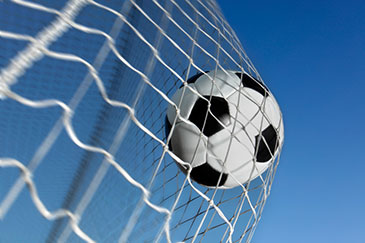Image of a football hitting the back of the net